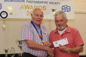 John being presented with a certificate by Barry Green